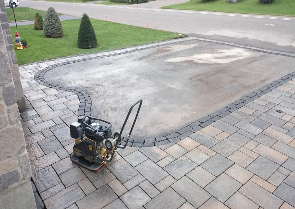 Final driveway interlock stone compacting